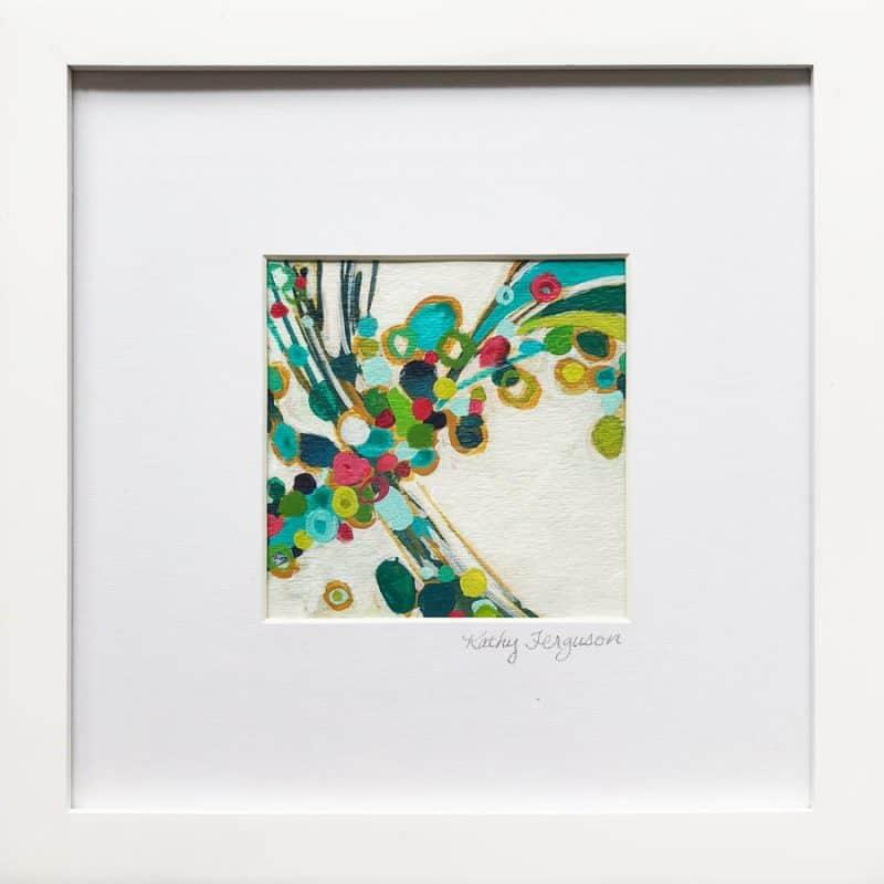 Colorful miniature acrylic circle painting 'Color Explosion' is a vibrant artwork of red, blue, and green, framed and matted behind glass.